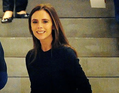 Victoria Beckham smiles