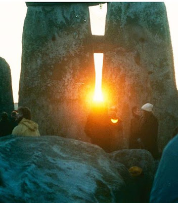 At Stonehenge on the winter solstice, the rising sun aligns perfectly with the large trio of monolithic stones and a flat stone table in the center of the structure