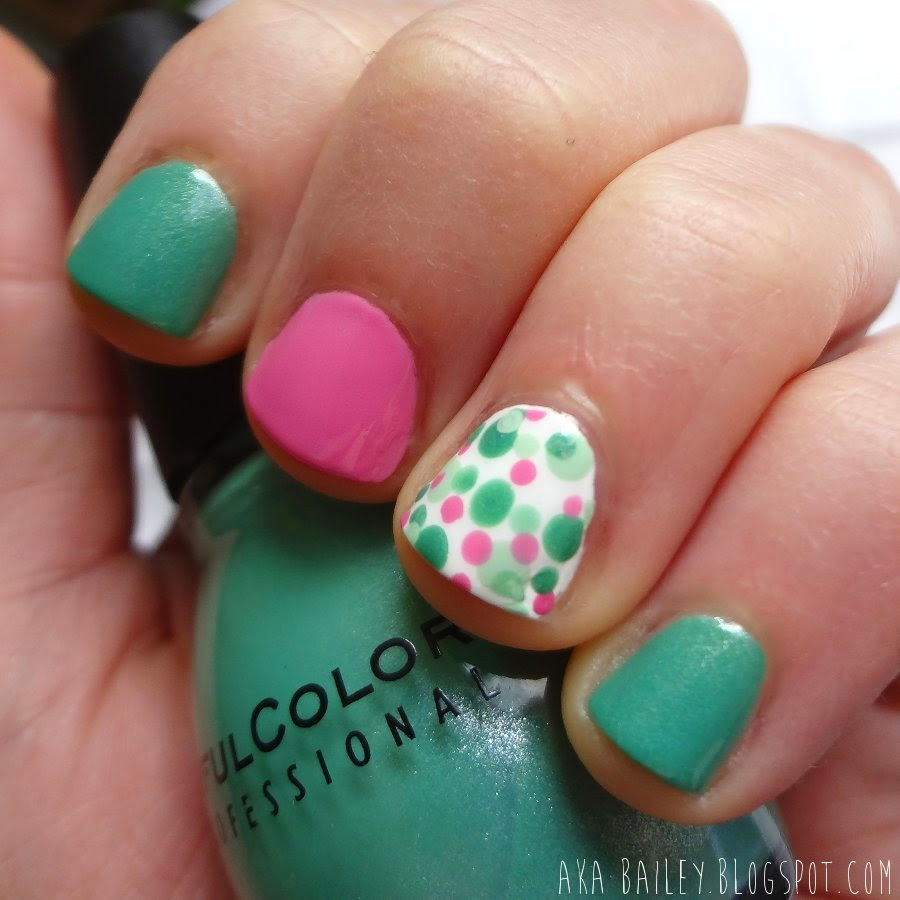 Mint green nails with pink and polka dot accent nails