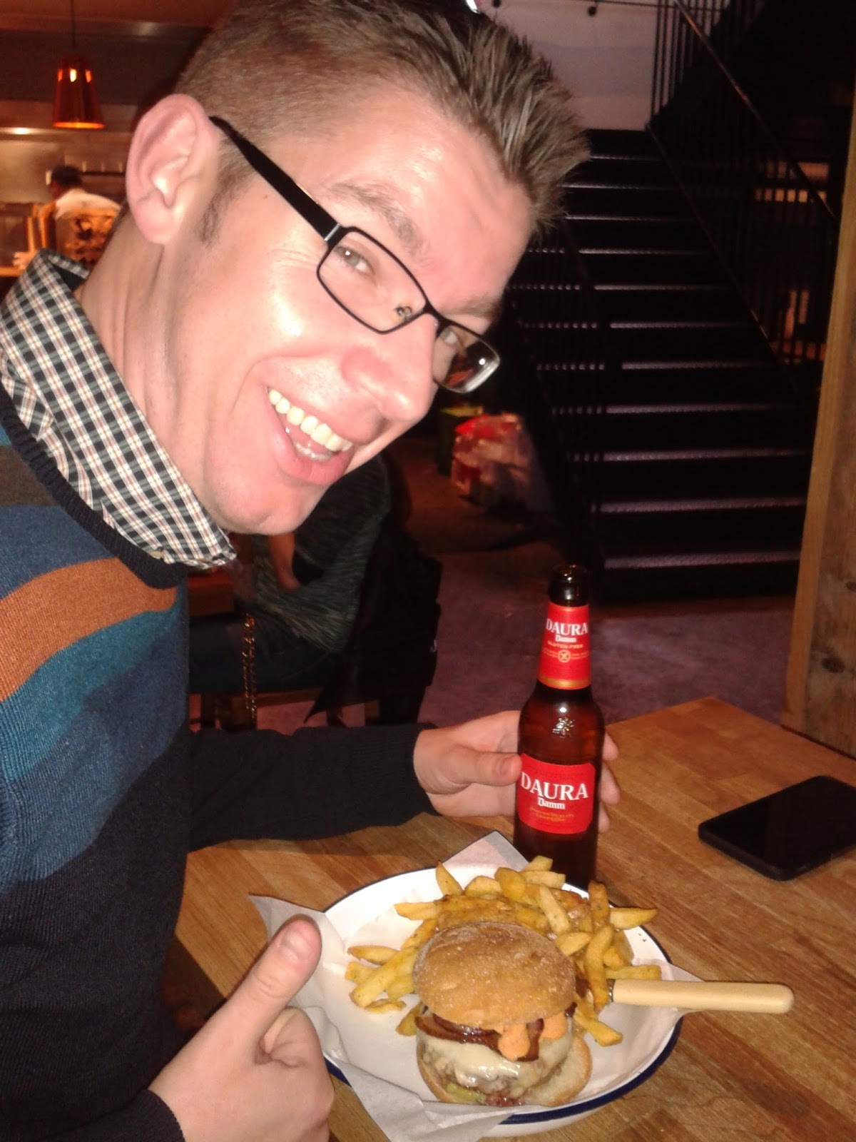 A very happy Coeliac with his gluten free burger, chips and beer at Honest Burgers