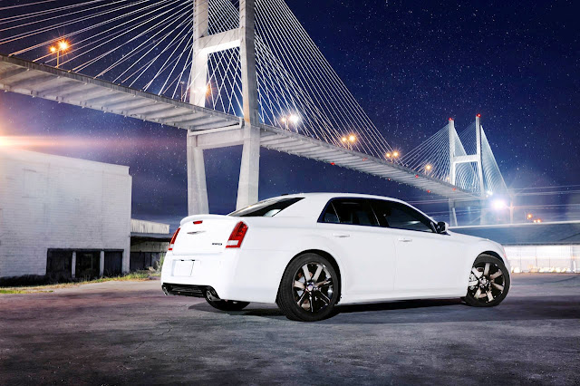 Rear 3/4 view of white 2012 Chrysler 300 SRT8 at night