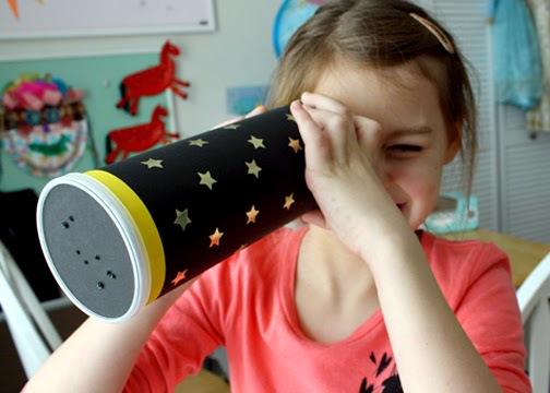 Tessa and I created a constellation viewer with an empty Pringles can, card stock and star stickers.