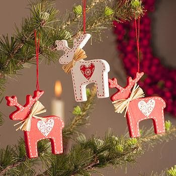 This style come from the Scandinavian countries - Sweden, Denmark, Finland  and Norway. You can use wooden decorations painted in white and red, ...