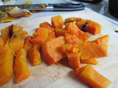 Chunks of roasted butternut squash on cutting board