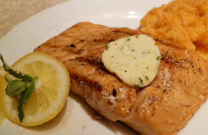 Grilled salmon with herb butter and sweet potato grits