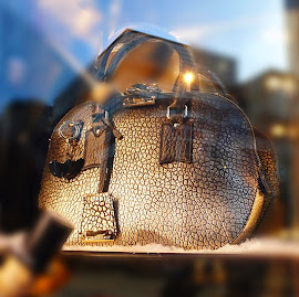 The bowling bag revisited in metallic leather from Burberry.