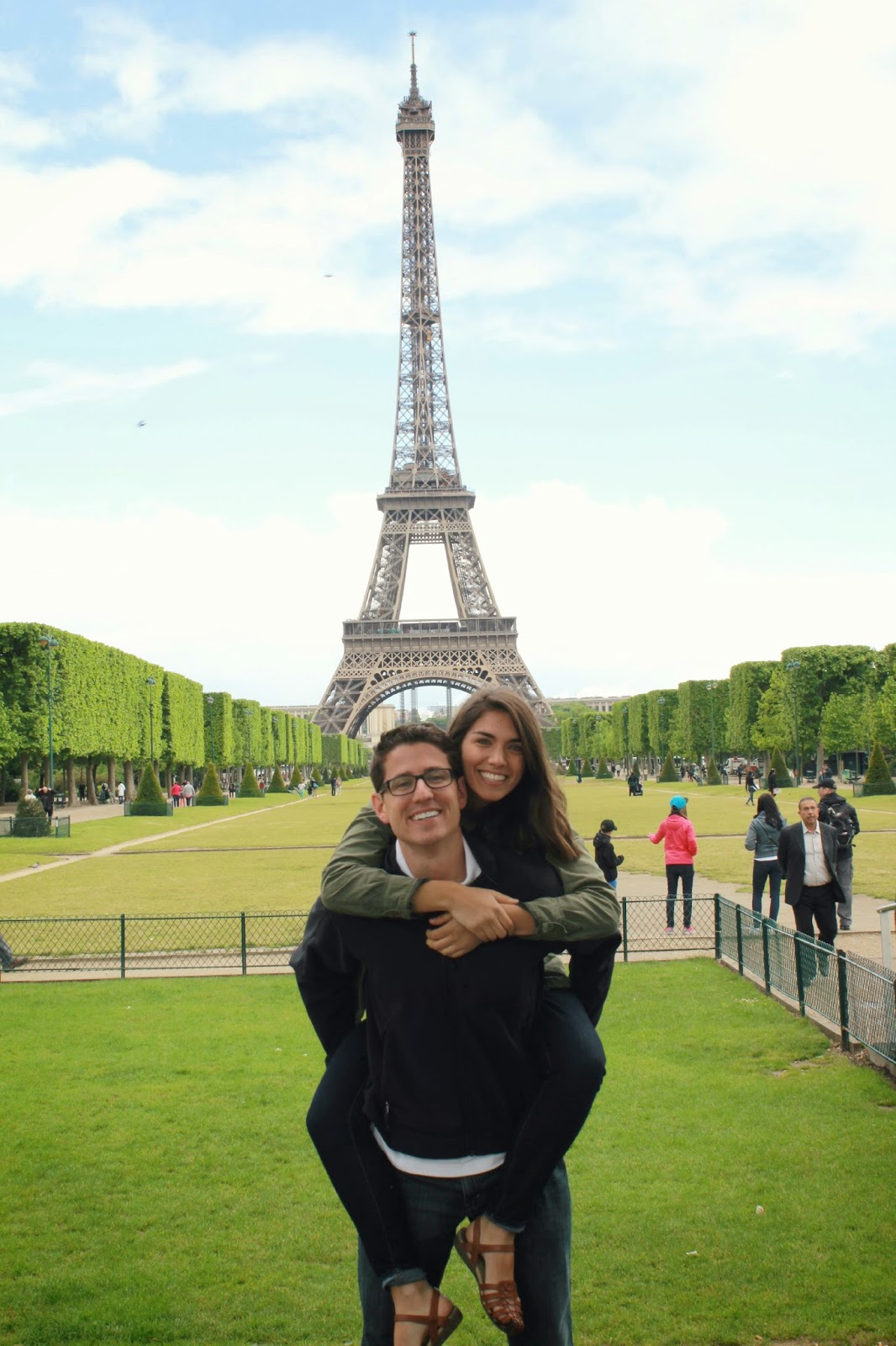 a couple in front of the Eiffel Tower