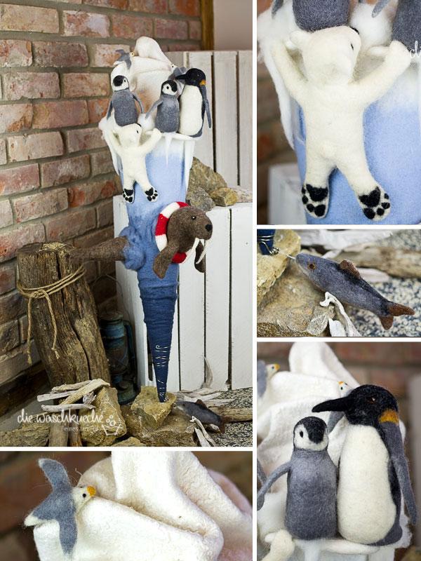 Schultüte mit Tieren der Arktis und Antarktis. Eisbär, Pinguin, Walross und Fisch.
