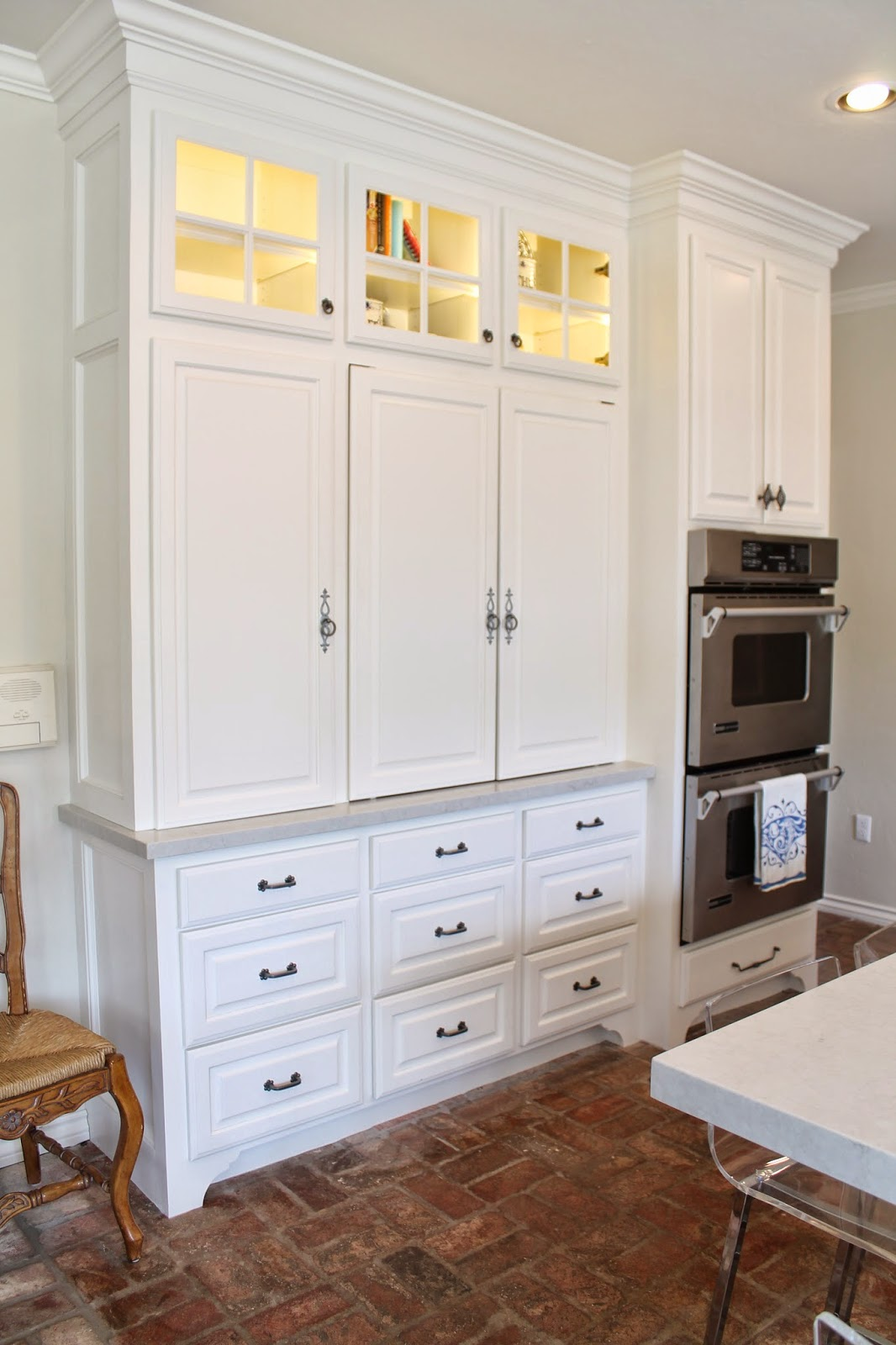Eleven gables hidden appliance cabinet and desk command for Cupboard in the kitchen
