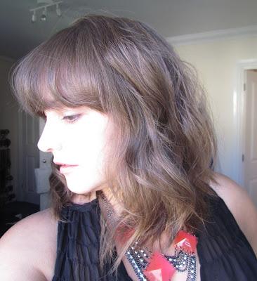 Wavy hair using GHD styling tool