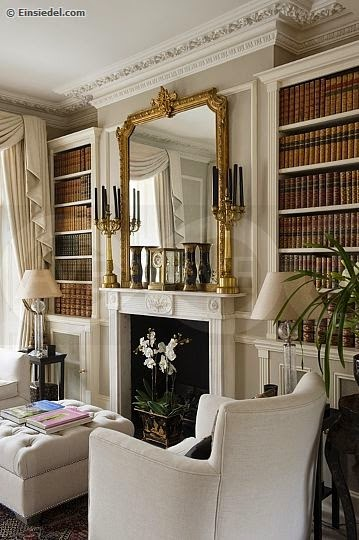traditional fire place living room built in bookcases