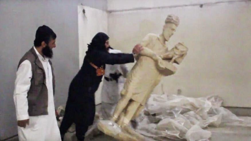Islamic State smash ancient Iraq statues in Mosul