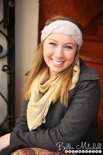 teen girl wearing gray wool jacket, gold scarf, and white knit headband
