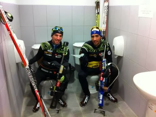 olympic skiers pose on side by sode toilets - sochi problems