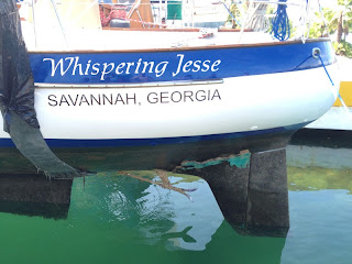 Whispering Jesse's damaged skeg comes into view