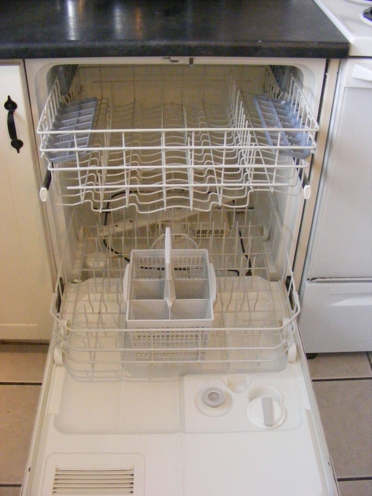How To Clean Your Dishwasher Without Gagging Too Much