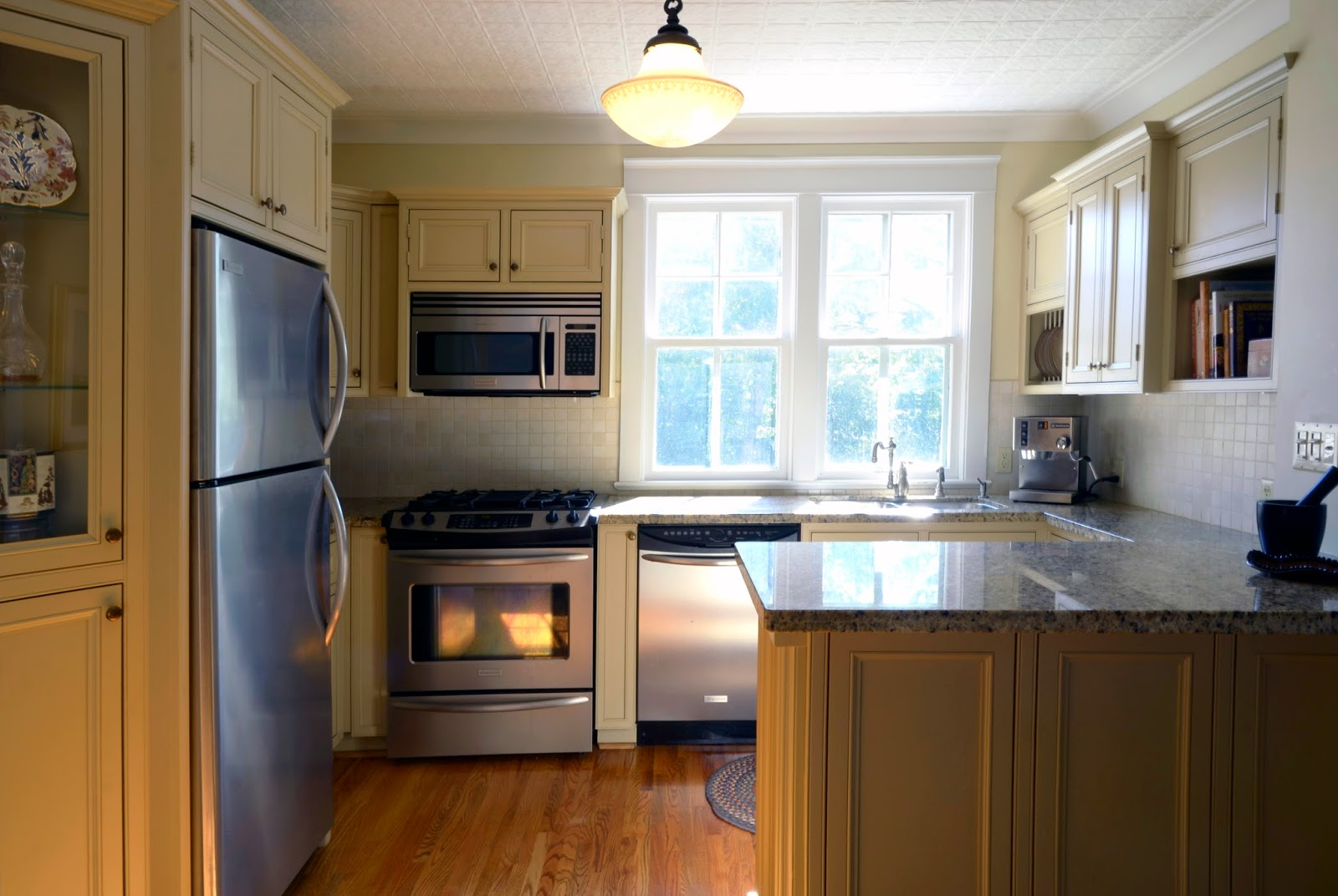 Matching stainless steel appliances include fridge, dishwasher