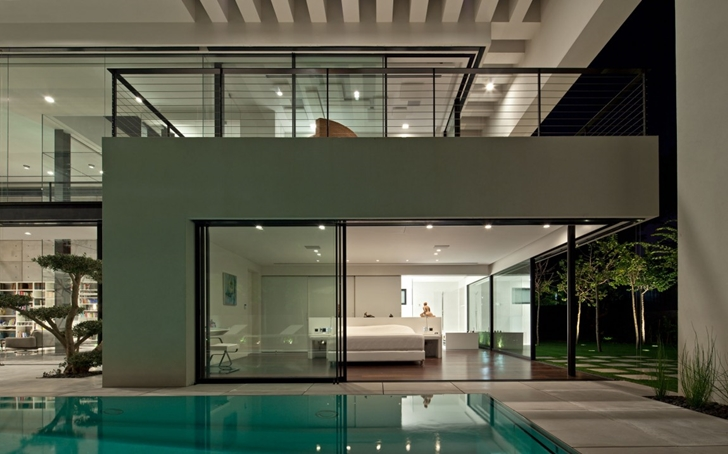 Glass wall of Modern Bauhaus Mansion In Israel at night