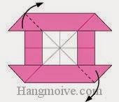 Bước 10: Gấp chéo hai cạnh có mũi tên vào trong.