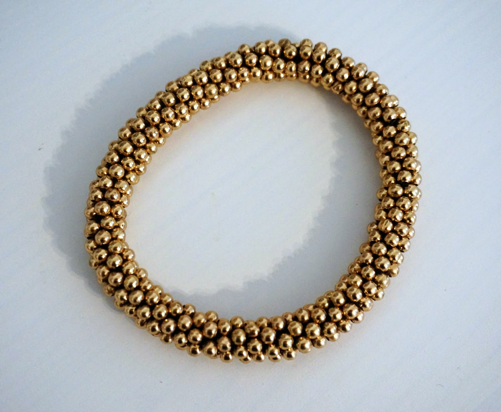golden bracelet with bobbles