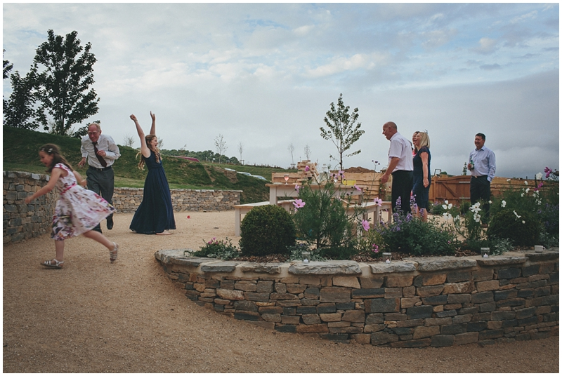 Guests playing outside at the Tithe Barn, Dorset