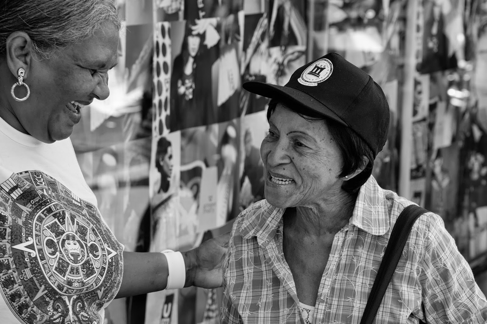 Two women share a joke.