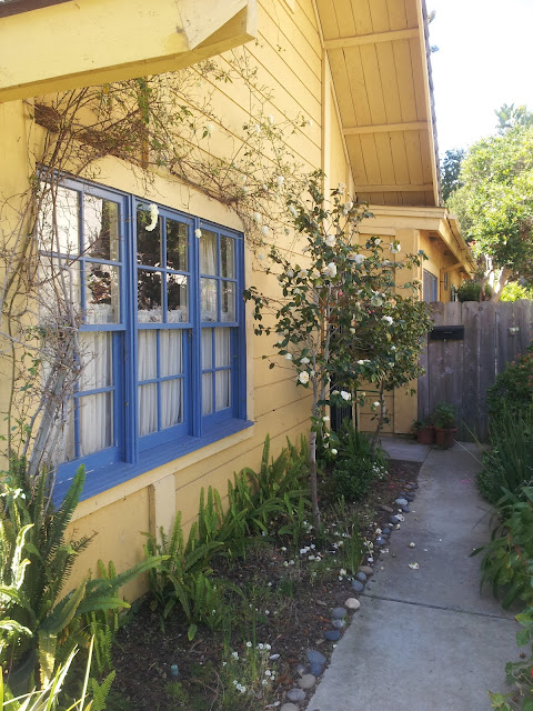 Southern California Beach Cottage, country style entrance way, yellow house with blue trim, from Studio, Garden and Bungalow