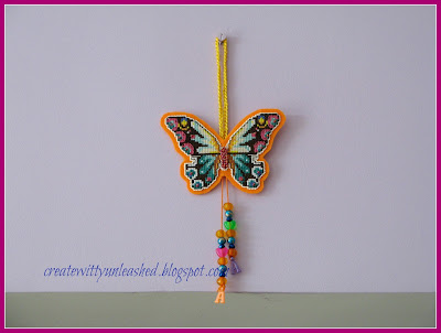 Cross stitched butterfly charm on plastic canvas 3
