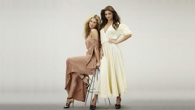 Miranda Kerr y Delta Goodrem con vestidos