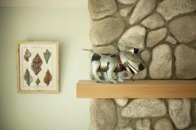 Creative cottage dog artwork on mantle