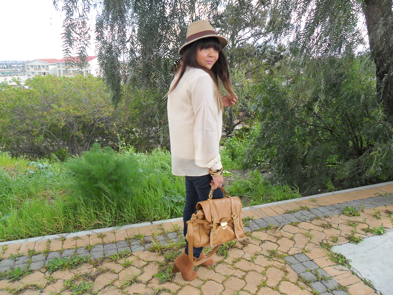 ombre hair, fedora, ankle boots, cream blouse, satchel, gold arm candy