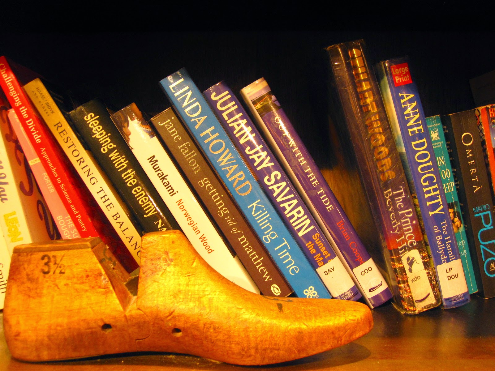 Vintage shoe last in front of a shelf of books at The Little Library in Melbourne Central.