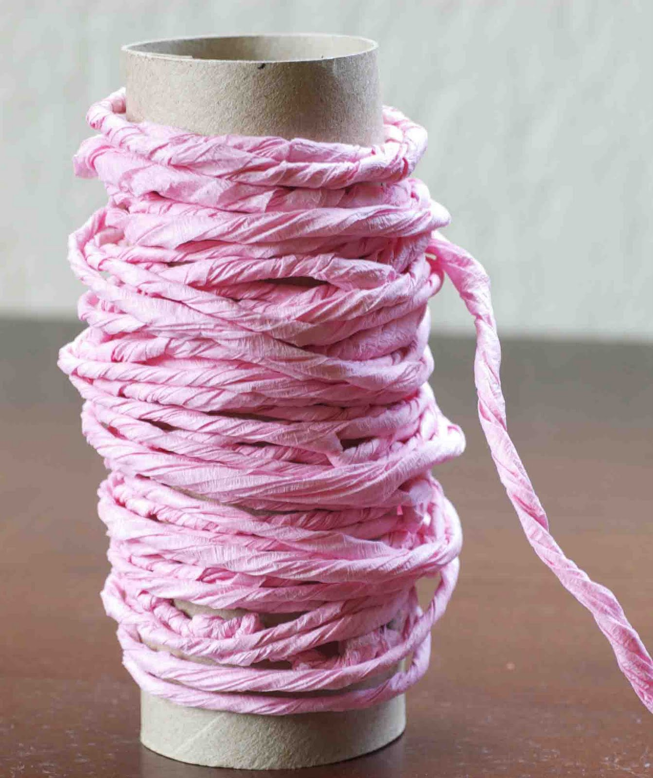 paper twine Paper twine can be expensive and comes in somewhat limited colors follow my instructions and you can make your own with crepe paper.
