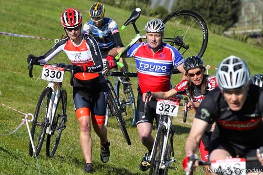 Centre: Stephen Holdsworth, masters 2 men, carries his bike up a hill. Others pushed, others rode - race including under 19 female, open female, masters 2 men, masters 3 men - round five, Endura National Chamopionships, run by Cyclocross Hawke's Bay, at Roy's Hill Reserve, SH50, Fernhill, Hastings photograph