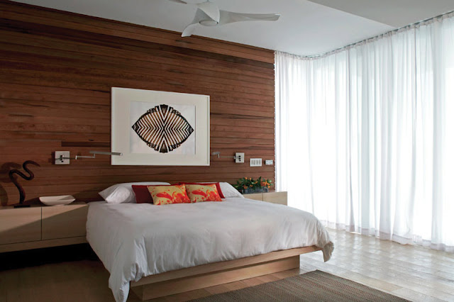 Modern bed by the wooden wall