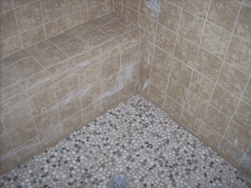 This is the master bathroom shower. We picked this pebble tile for the  title=