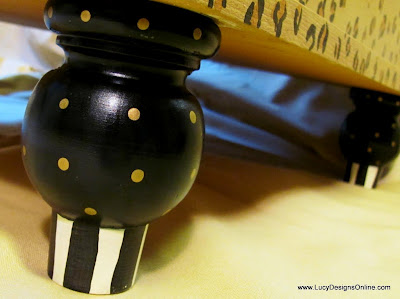hand painted dotted and striped wooden finial feet