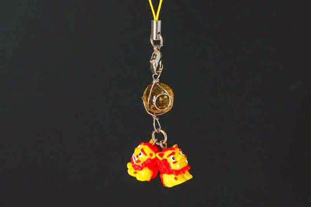 golden ball, trinket, shisa