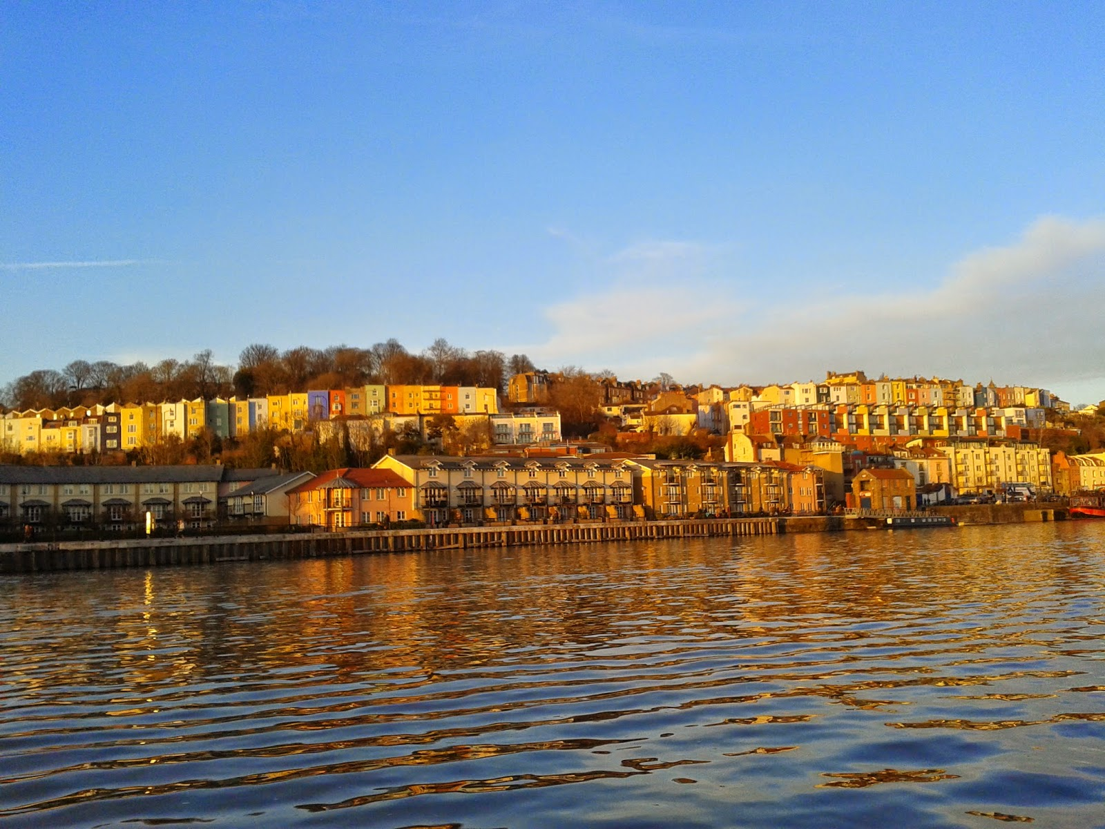 Coloured terraced houses across the Bristol harbour