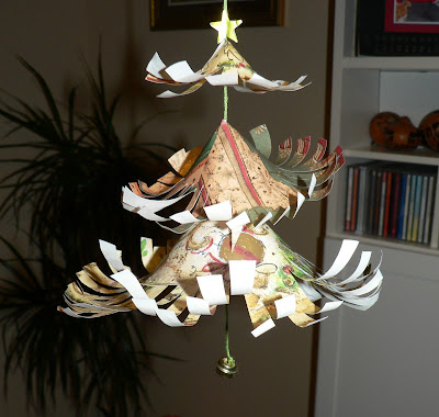 finished patterned curled paper christmas tree decoration with jingle bell