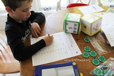 Kid playing Germ-themed math game from STEMmom.org
