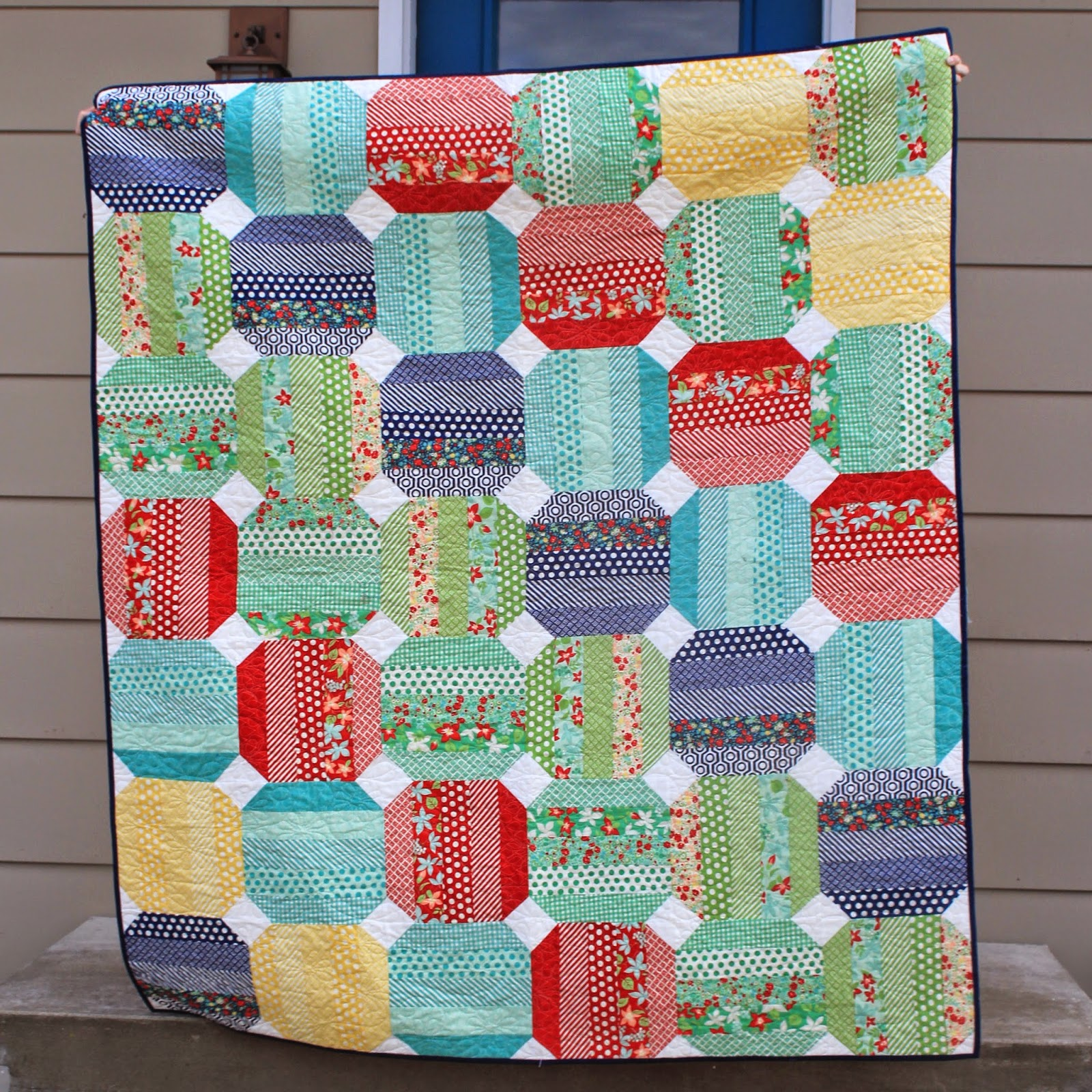 Bonnie and Camille's April Showers quilt with jelly rolls