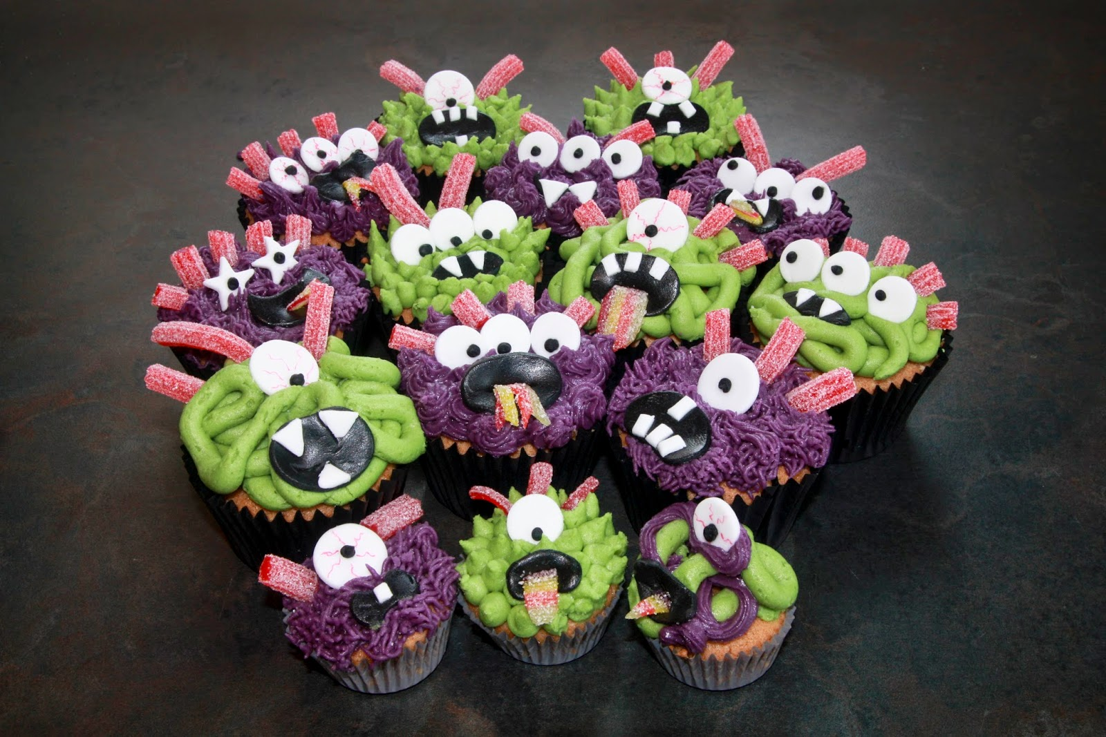 Purple and green monster cupcakes