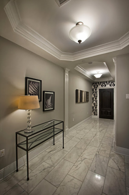 a bright, stunning entryway that boasts fun pattern play and elegance in its soft color hues and minimal furnishings