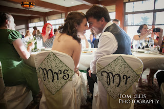 Mrs. and Mr. enjoy the moment at their wedding reception - Kent Buttars, Seattle Wedding Officiant