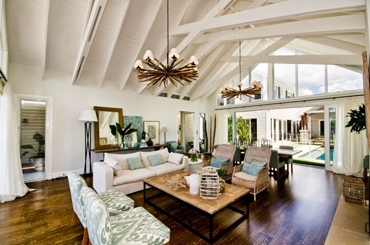 Bright living room in Beautiful seaside home by BGD Architects