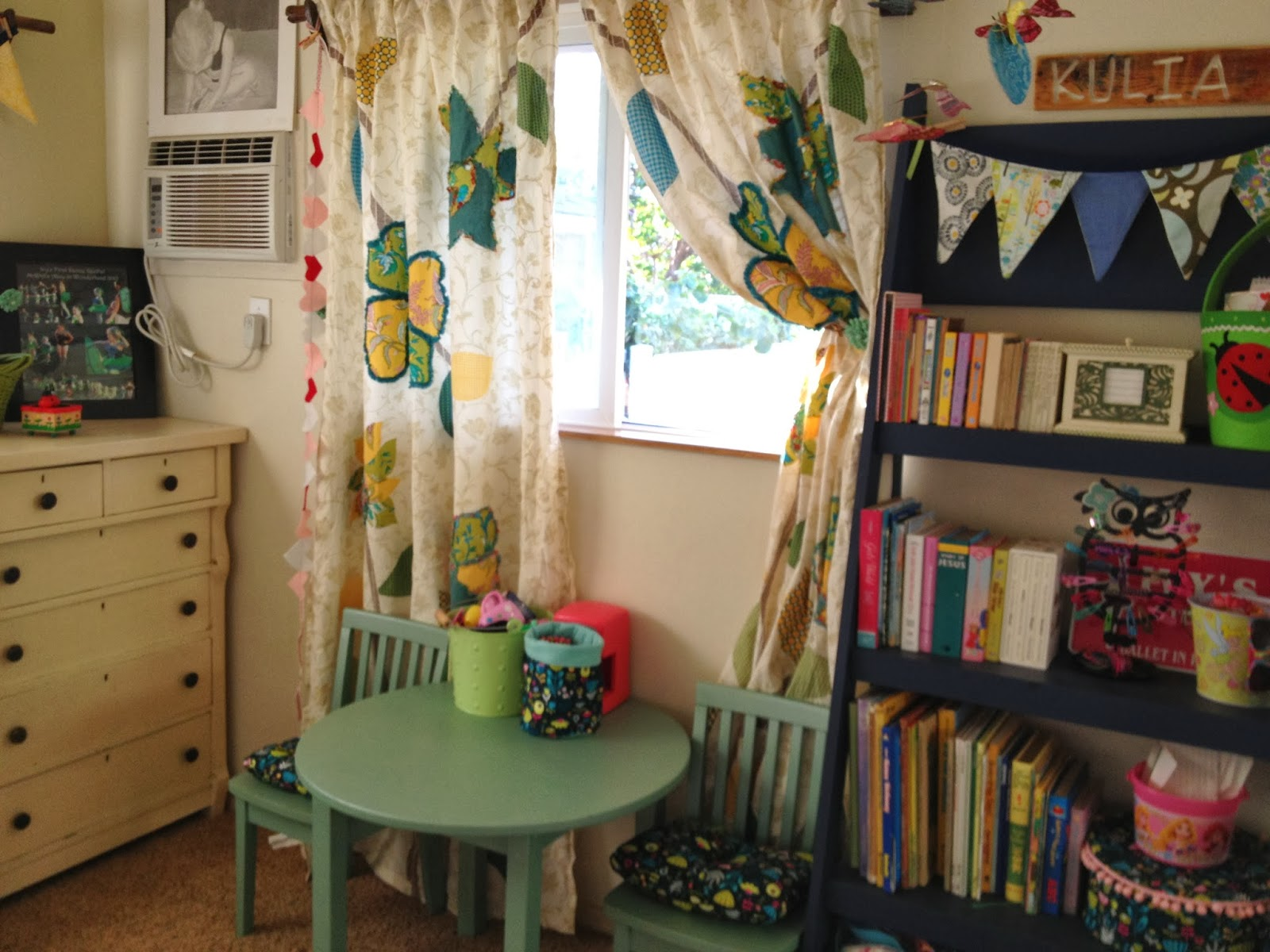 kids room with aqua table and chair bookshelf