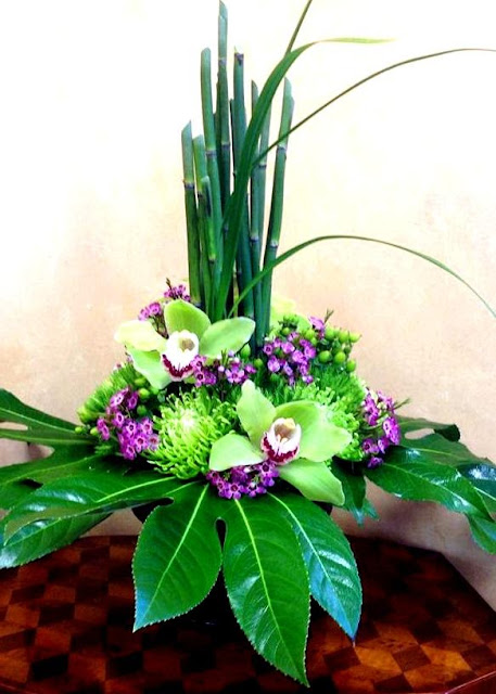 Isha Foss Events equisitum, fatsia, cymbidiuns, fuji mums, lily grass, waxflower