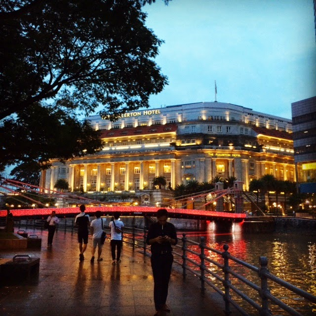 The Singapore River, the Cavenagh Bridge over it, and the Fullerton Hotel