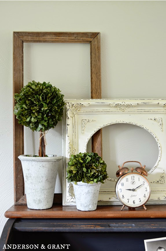 Decorating with empty picture frames can be an inexpensive way to add instant style to your space. | www.andersonandgrant.com